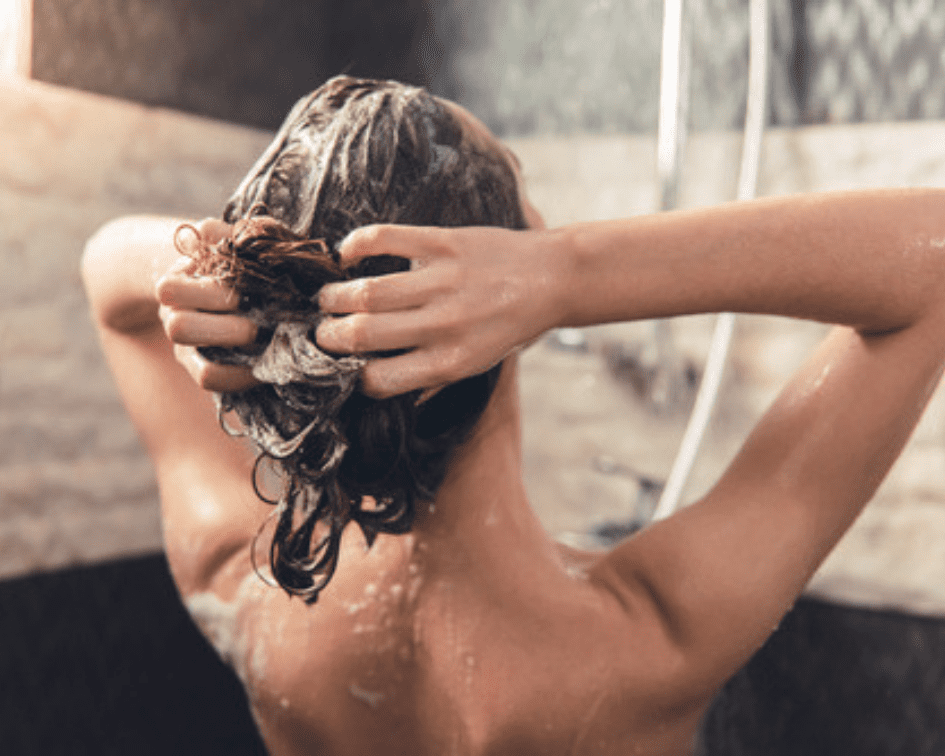 Lady Washing Hair To De-Stress