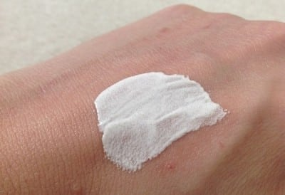 Lady With Cream On Her Hand To Embrace Cream For Her Dry Skin