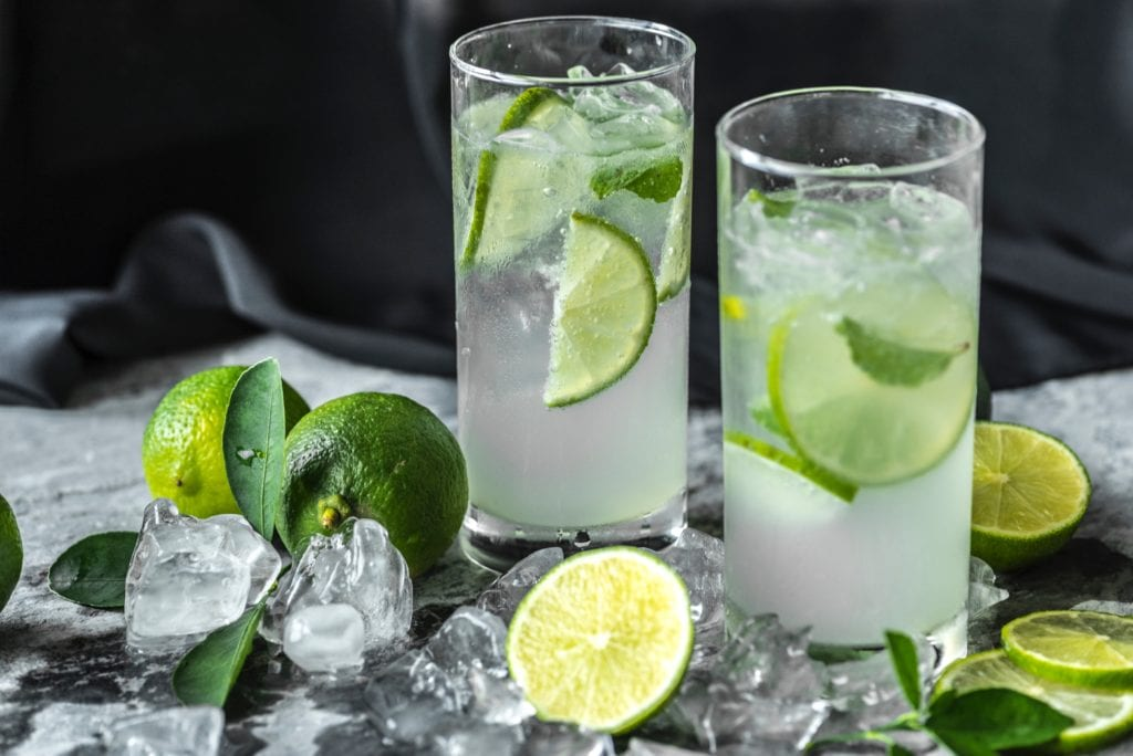 glasses of water and limes for skin detox