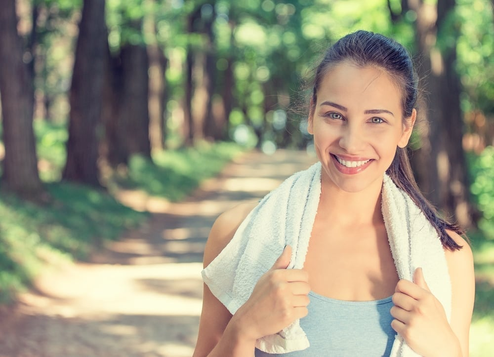 young healthy woman smiling at the park