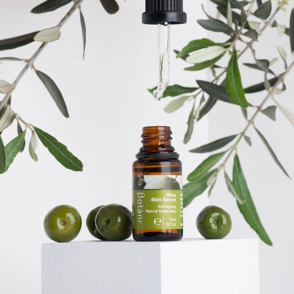 Olive Skin Serum Dripping from the Dropper, featuring fresh Olives.